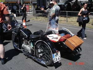 A kid takes a nap in the sidecar of a family bike